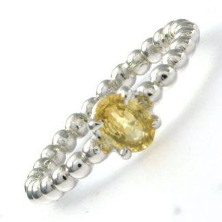 """Bague """"Mimosa"""" Saphir jaune oval  en or blanc réf. 1158"""